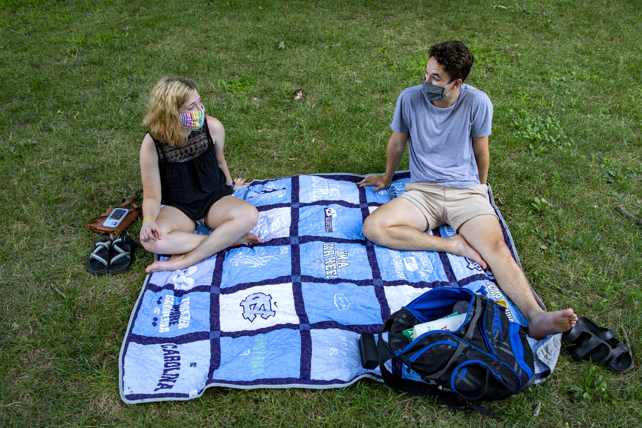 Students on lawn on campus.
