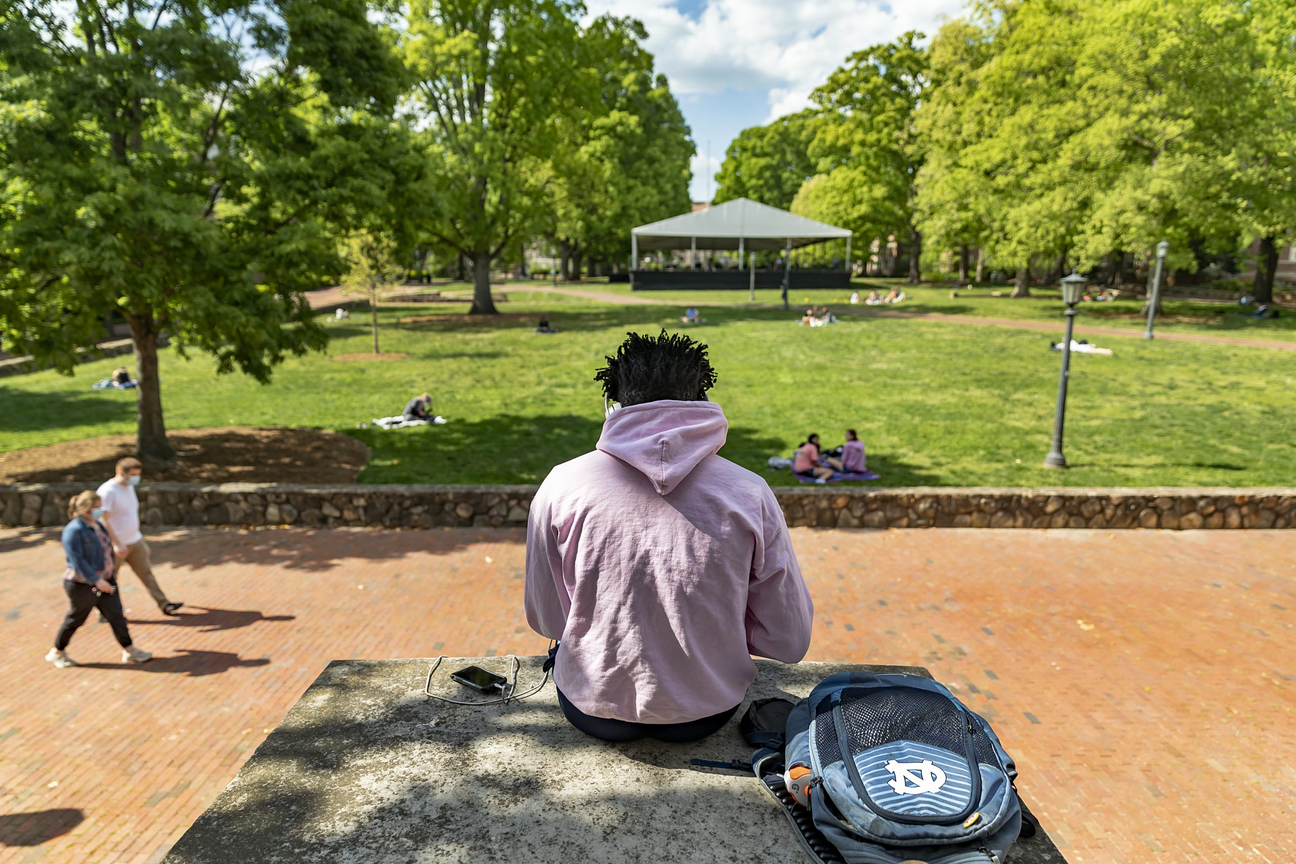 Student sitting outdoors on campus.