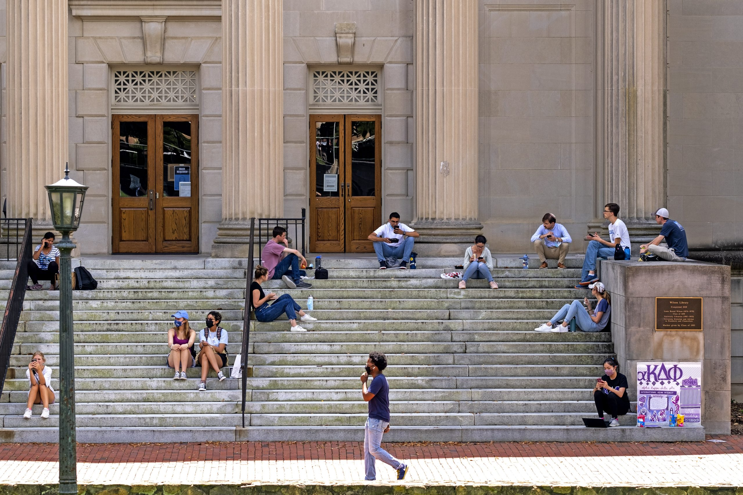 Students sitting on steps at Wilson library